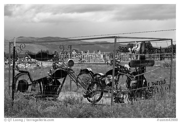 Grave with motorbikes, Truchas. New Mexico, USA (black and white)
