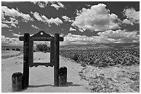 Marker and high desert scenery. New Mexico, USA (black and white)
