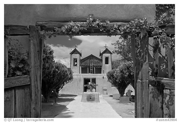 Church framed by doors with roses, Sanctuario de Chimayo. New Mexico, USA (black and white)