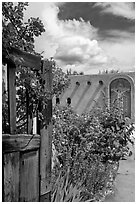 Gardens and adobe wall, Sanctuario de Chimayo. New Mexico, USA ( black and white)