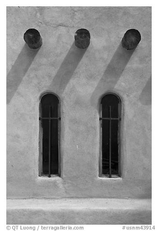 Vigas and deep windows in pueblo style, Sanctuario de Chimayo. New Mexico, USA