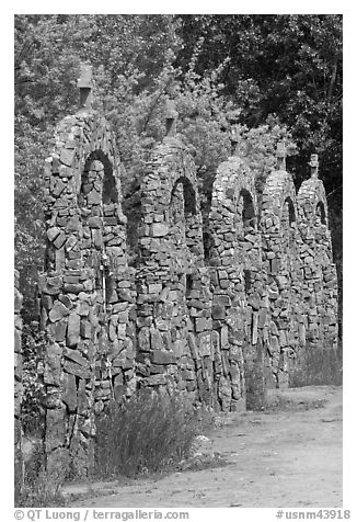Row of crosses, Sanctuario de Chimayo. New Mexico, USA (black and white)