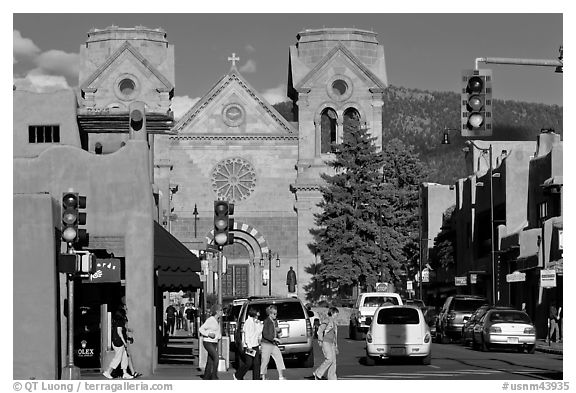 Pedestrians and street with cathedral, downtown. Santa Fe, New Mexico, USA (black and white)