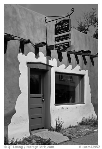 Door, window, and sign indicating oldest house. Santa Fe, New Mexico, USA (black and white)