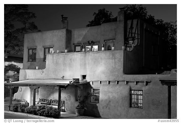 House in Spanish pueblo revival style by night. Santa Fe, New Mexico, USA