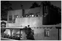 House in Spanish pueblo revival style by night. Santa Fe, New Mexico, USA ( black and white)