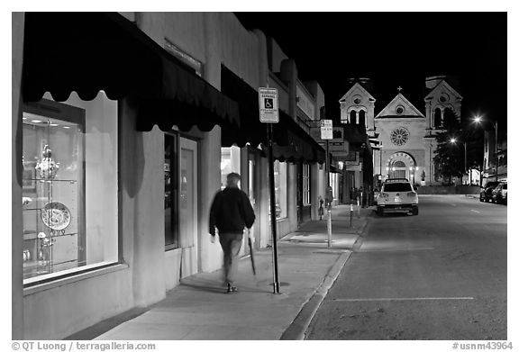 Man walking gallery and St Francis by night. Santa Fe, New Mexico, USA (black and white)