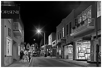 Street with galleries, people walking, and cathedral by night. Santa Fe, New Mexico, USA (black and white)