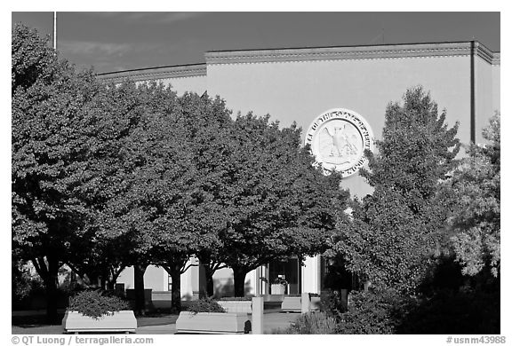 New Mexico State Capitol East entrance and trees. Santa Fe, New Mexico, USA (black and white)