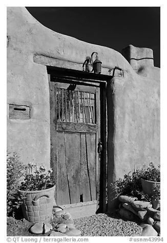 Wooden door and adobe wall. Santa Fe, New Mexico, USA (black and white)