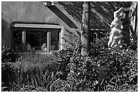 Front yard with sculpture, Canyon Road. Santa Fe, New Mexico, USA (black and white)