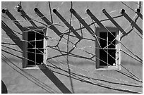 Detail of art installation on facade of adobe building. Santa Fe, New Mexico, USA ( black and white)