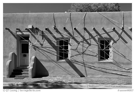 Adobe building tied up with plastic bags. Santa Fe, New Mexico, USA (black and white)