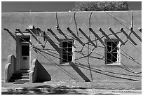 Adobe building tied up with plastic bags. Santa Fe, New Mexico, USA ( black and white)