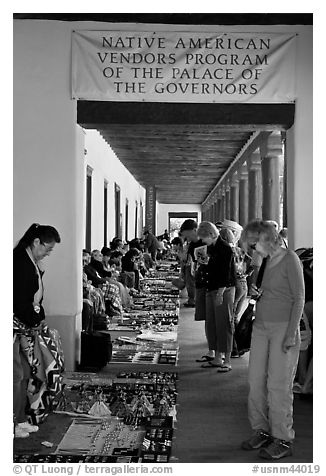 Visitors browse wares sold under native american vendors program of the palace of the governors. Santa Fe, New Mexico, USA