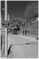 Street with Oldest House sign. Santa Fe, New Mexico, USA ( black and white)