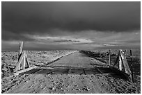 Cattle guard and unpaved road. New Mexico, USA (black and white)