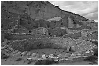 Kiva and multi-storied roomblocks, Pueblo Bonito. Chaco Culture National Historic Park, New Mexico, USA (black and white)