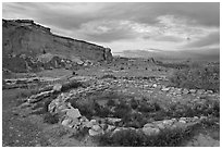Great Kiva and cliff at sunset, Pueblo Bonito. Chaco Culture National Historic Park, New Mexico, USA (black and white)