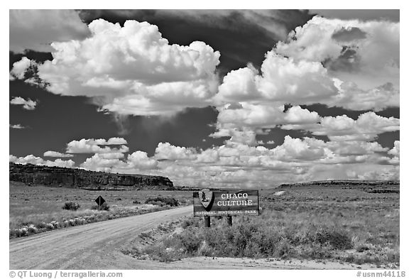 Sign and road at the entrance. Chaco Culture National Historic Park, New Mexico, USA (black and white)