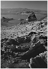 Tufa rock and pyramid. Pyramid Lake, Nevada, USA (black and white)