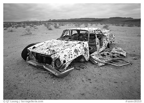 Car wreck used as a shooting target. Nevada, USA (black and white)