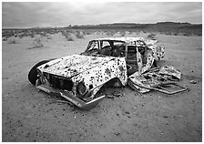 Car wreck used as a shooting target. Nevada, USA ( black and white)