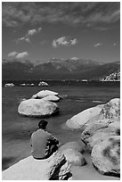 Man sitting on boulder, Sand Harbor, Lake Tahoe-Nevada State Park, Nevada. USA ( black and white)