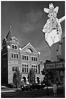 Giant Cactus Jack sign and brick building. Carson City, Nevada, USA ( black and white)