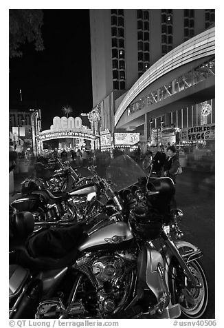Harley-Davidson motorcycles on downtown street at night. Reno, Nevada, USA