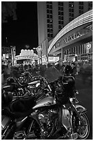 Harley-Davidson motorcycles on downtown street at night. Reno, Nevada, USA (black and white)