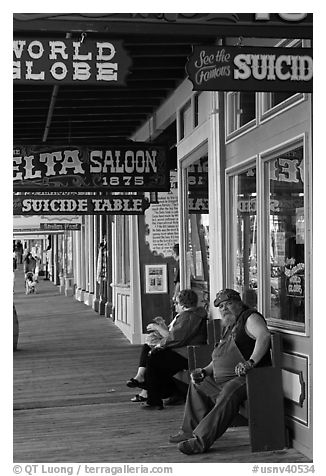 Arcade with suicide table sign. Virginia City, Nevada, USA