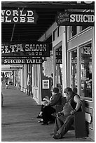 Arcade with suicide table sign. Virginia City, Nevada, USA (black and white)