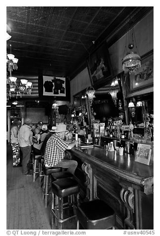 Men inside historic saloon. Virginia City, Nevada, USA (black and white)