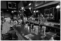 Man sitting at bar. Virginia City, Nevada, USA ( black and white)