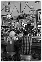 Man and woman sitting in saloon. Virginia City, Nevada, USA ( black and white)