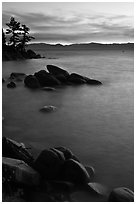 Sunset over lake with boulders, Sand Harbor, East Shore, Lake Tahoe, Nevada. USA (black and white)