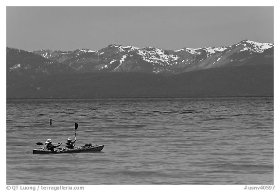Kayak, turquoise waters and snowy mountains, East Shore, Lake Tahoe, Nevada. USA (black and white)