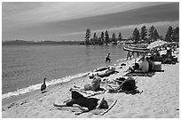 Families on sandy beach, Lake Tahoe-Nevada State Park, Nevada. USA ( black and white)