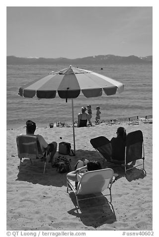 Beach unbrella and family, Sand Harbor, Lake Tahoe-Nevada State Park, Nevada. USA (black and white)