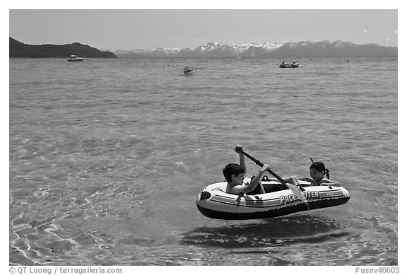 Children playing in inflatable boat, Sand Harbor, Lake Tahoe-Nevada State Park, Nevada. USA (black and white)
