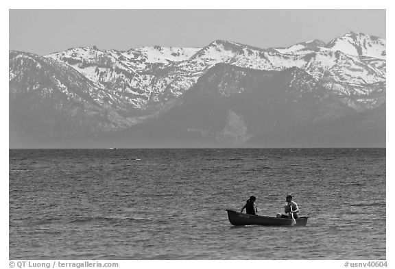 Canoe and snowy mountains, Lake Tahoe, Nevada. USA (black and white)