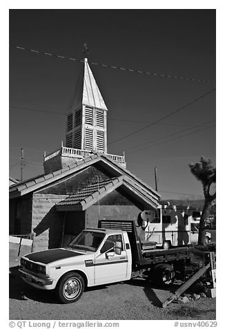 Truck and house with bell-tower, Beatty. Nevada, USA (black and white)