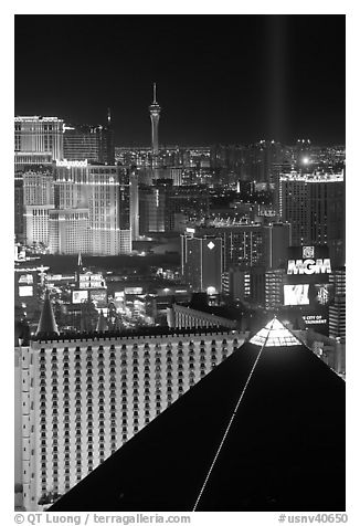 Luxor pyramid, casinos, and Stratosphere tower at night. Las Vegas, Nevada, USA (black and white)