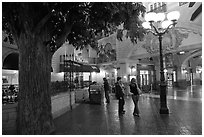 Man and woman standing on plaza inside Paris casino. Las Vegas, Nevada, USA (black and white)