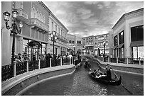 Gondolas and Grand Canal bordered by shops in the Venetian casino. Las Vegas, Nevada, USA ( black and white)