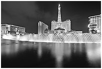 Bellagio dancing fountains and hotels reflected in lake. Las Vegas, Nevada, USA (black and white)