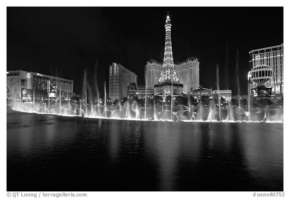 Bellagio dancing fountains and casinos reflected in lake. Las Vegas, Nevada, USA