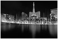 Bellagio dancing fountains and casinos reflected in lake. Las Vegas, Nevada, USA (black and white)