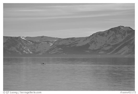Kayak in the distance and mountains in winter, Lake Tahoe, Nevada. USA (black and white)